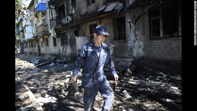 A firefighter walks past the rubble of a building destroyed by shelling in Donetsk, Ukraine, on Wednesday, September 17. Fighting between Ukrainian troops and pro-Russian rebels in the country has left more than 3,000 people dead since mid-April, according to the United Nations.