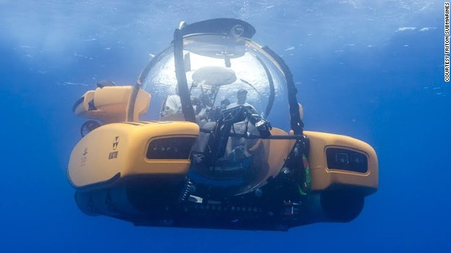 Also making a splash at the yacht show is the Triton Submarine, a powerful vessel capable of exploring the darkest depths of the ocean.
