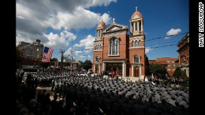An honor guard carries the casket of Pennsylvania State Trooper Cpl. Bryon Dickson from his funeral service in Scranton, Pennsylvania, on Thursday, September 18.