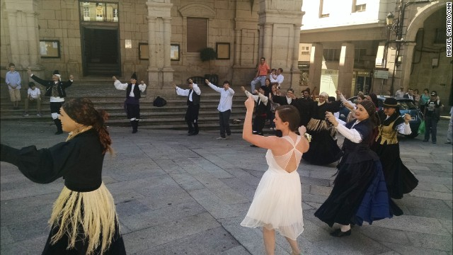 "OURENSE, SPAIN: ""Members of the folklore dancing group Castrofloxo, celebrate with a traditional muiñeira dance after a wedding in Ourense old town in Galicia."" - CNN's Miguel Castro. Follow Miguel (@sambassando) and other CNNers along on Instagram at instagram.com/cnn."