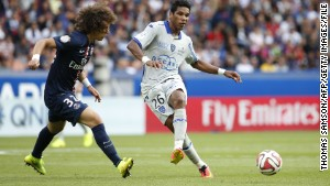 Paris Saint-Germain defender David Luiz vies for the ball with Bastia's Brandao (right) during the match at Parc des Princes in August.