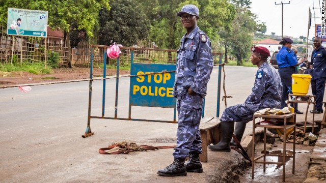 Police in Freetown, Sierra Leone, guard a roadblock Friday, September 19, as the country began enforcing a three-day nationwide lockdown.