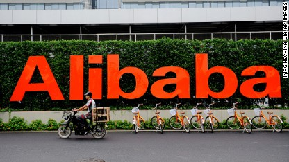 Alibaba surges in IPO debut