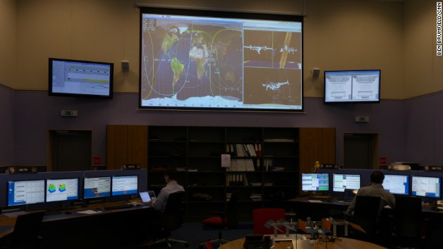 Scientists at CERN's AMS control center in France monitor the path of the ISS and adjust the spectrometer experiment to changing space conditions.