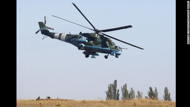 A Ukrainian attack helicopter patrols an area near Donetsk on September 20.