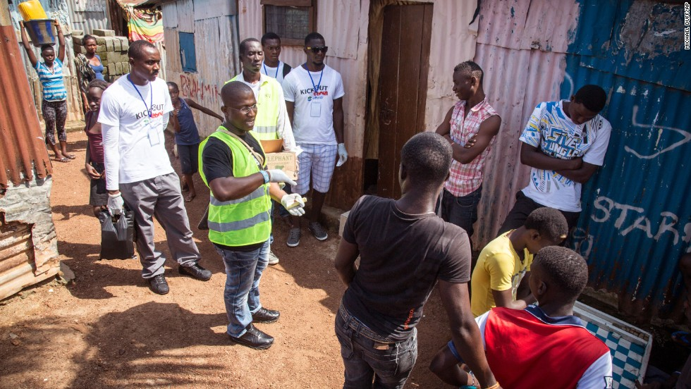 A volunteer health worker talks with residents on how to prevent Ebola infection and identify symptoms of the virus in others, and distributes bars of soap in Freetown, Sierra Leone, Saturday, September 20. The West African nation is under a government-instituted lockdown in an attempt to curb the spread of the disease. No one will be allowed to leave their homes for three days, and volunteers will be allowed to go door to door to educate people on the Ebola virus.