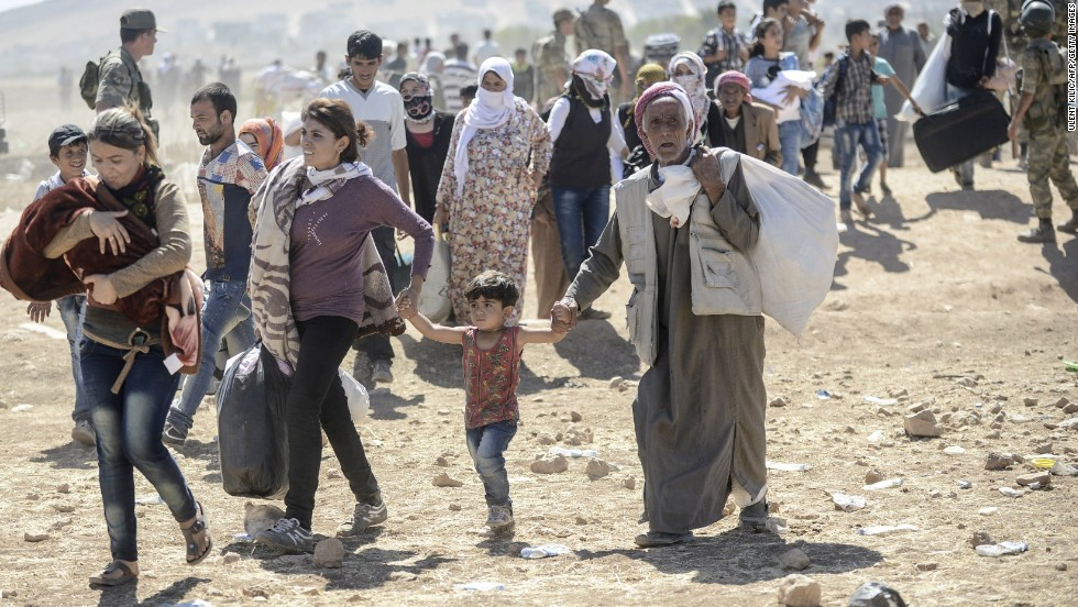 Syrian Kurds fleeing the violence from ISIS wait to cross on Saturday, September 20 at the border from Syria into Turkey near the southeastern town of Suruc in Sanliurfa province. The United Nations estimates more than 190,000 people have been killed in Syria since an uprising in March 2011 spiraled into civil war.