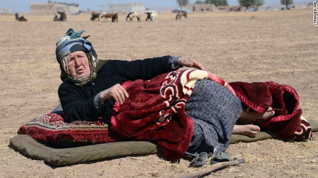 A Syrian Kurdish refugee woman at the border in Suruc, Turkey, on September 20.