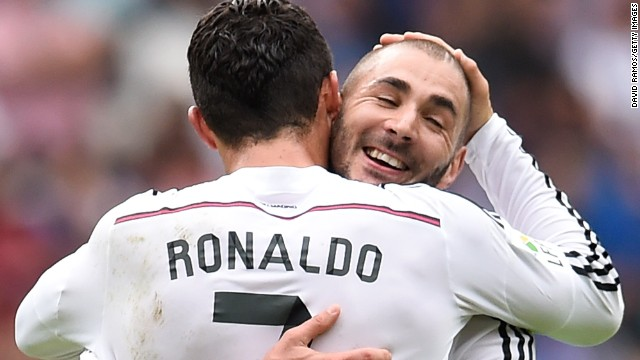 World player of the year Ronaldo celebrates with Karim Benzema after a goalkeeping error by German Lux gifted him a second goal for 3-0.