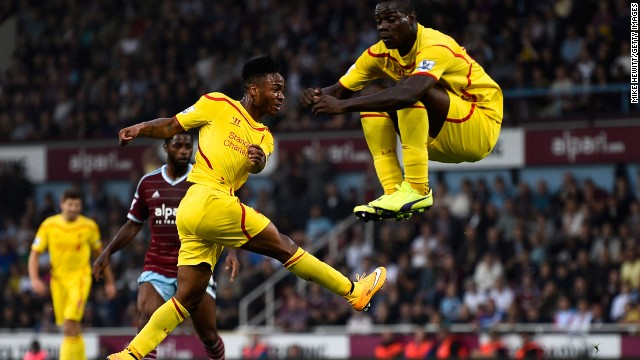 Raheem Sterling pulled a goal back before halftime as teammate Balotelli takes evasive action.