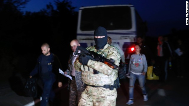 A Ukrainian soldier guards pro-Russian forces during a prisoner exchange near Donetsk on September 21.