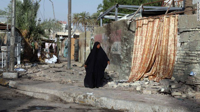 "A woman walks around the site of a car bomb attack in Baghdad, Iraq, on Friday, September 19. Some of the world's top diplomats have pledged to support Iraq in its fight against ISIS militants by ""any means necessary,"" including ""appropriate military assistance."" ISIS has taken over large swaths of northern and western Iraq as it seeks to create an Islamic caliphate that stretches from Syria to Iraq."