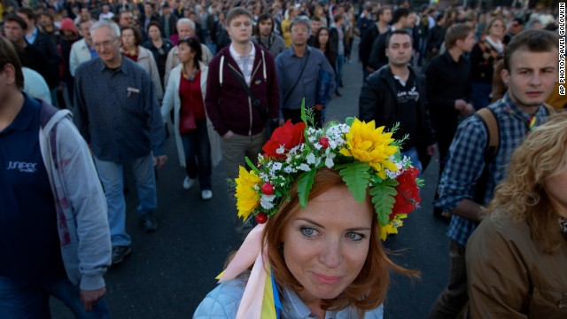 SEPTEMBER 22 - MOSCOW, RUSSIA: A protester wears traditional Ukrainian flower headband during an anti-war rally in Moscow. Several thousand people took to the streets of the Russian capital to protest the war in Ukraine and how Kremlin has handled the crisis there.