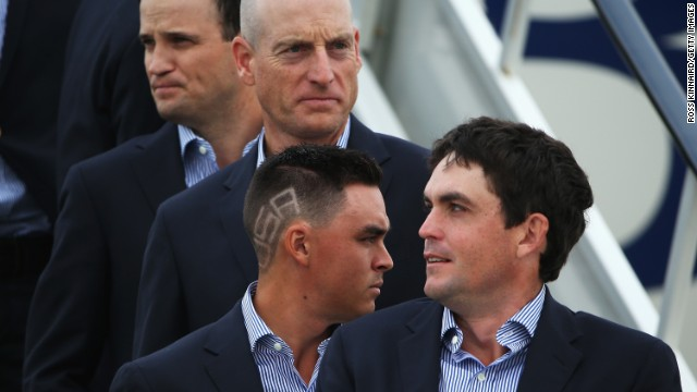 Fowler's haircut certainly ensured he stood out from the crowd as he touched down at Edinburgh Airport with teammates Keegan Bradley (front), Jim Furyk (center) and Zach Johnson (rear.)