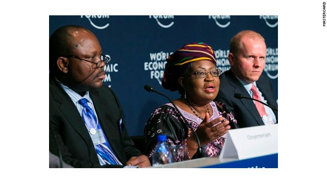 Nigeria's Finance Minister Ngozi Okonjo-Iweala discusses MasterCard collaboration with senior officials at the World Economic Forum