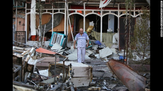 A man walks amid debris at the site of a car bomb attack in Baghdad, Iraq, on Wednesday, September 24.