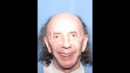 Music legend and convicted killer Phil Spector's latest prison mugshots show both a happy and a sad face.
