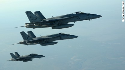 In this Tuesday, Sept. 23, 2014 photo released by the U.S. Air Force, a formation of U.S. Navy F-18E Super Hornets leaves after receiving fuel from a KC-135 Stratotanker over northern Iraq, as part of U.S. led coalition airstrikes on the Islamic State group and other targets in Syria.