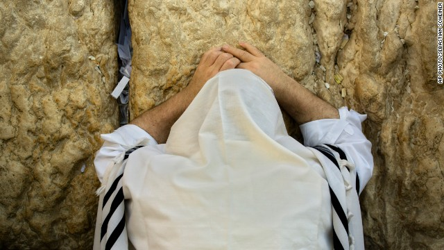 "SEPTEMBER 25 - JERUSALEM: An ultra-Orthodox man prays at the Western Wall, <a href='http://edition.cnn.com/2014/09/24/world/meast/jewish-new-year-shofar/'>marking Rosh Hashanah</a>, the beginning of year 5,775 in the Jewish calendar. Jews believe the occasion is a time for reflection and repentance and is referred to as the ""day of judgment"" or the ""day of repentance."""