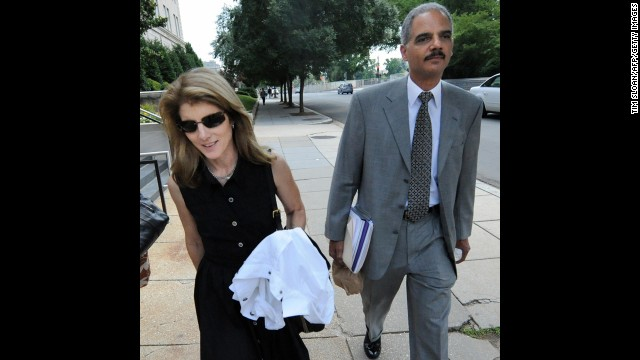 Holder walks with Caroline Kennedy, daughter of former President John F. Kennedy, in June 2008 after they were tasked with searching for a running mate for Obama.