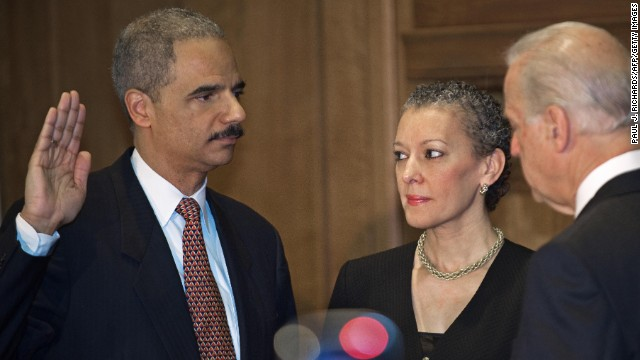 Holder is sworn in as attorney general by Vice President Joe Biden in February 2009. Holder's wife, Sharon, is by his side.