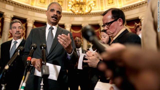 Holder talks to reporters after meeting with U.S. Rep. Darrell Issa, chairman of the House Oversight and Government Reform Committee, in June 2012. Issa and Holder met to discuss releasing documents related to the botched <a href='http://www.cnn.com/2013/08/27/world/americas/operation-fast-and-furious-fast-facts/'>Fast and Furious</a> investigation.