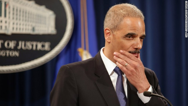 Holder takes questions during a news conference in May 2013. He said he recused himself from a national security leak investigation in which prosecutors obtained the phone records of Associated Press journalists.