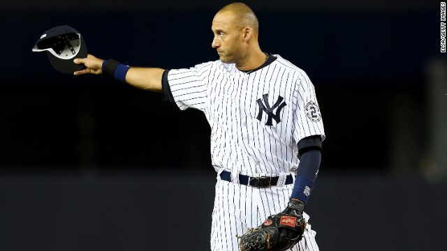 Jeter gestures to the fans during his last game at Yankee Stadium on Thursday, September 25.