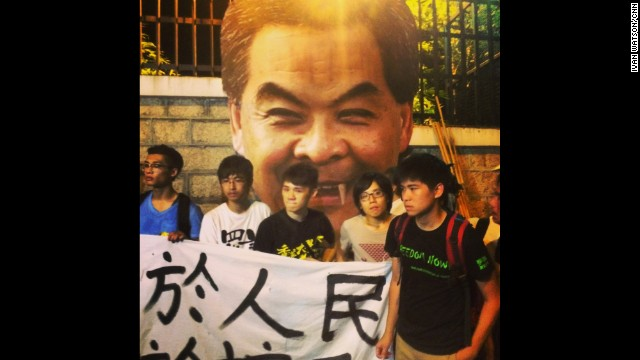 "HONG KONG: ""This kind of protest, mocking Hong Kong's top official at the gates of his residence, simply wouldn't be tolerated on mainland China. These university students fear their freedoms of expression are under threat from the ruling Communist Party. Though there's little hope among demonstrators of changing Beijing's policy towards this former British Colony, protesters say it's their duty to protect their rights."" - CNN's Ivan Watson, September 25. WATCH THE INSTAGRAM VIDEO from Ivan as students on unauthorized protest march in downtown Hong Kong chanting ""open the road"" at police. Follow Ivan (@ivancnn) and other CNNers along on Instagram at instagram.com/cnn."