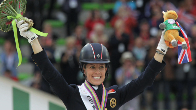 Charlotte Dujardin has broken her own dressage world record at the Olympia Horse Show in London.