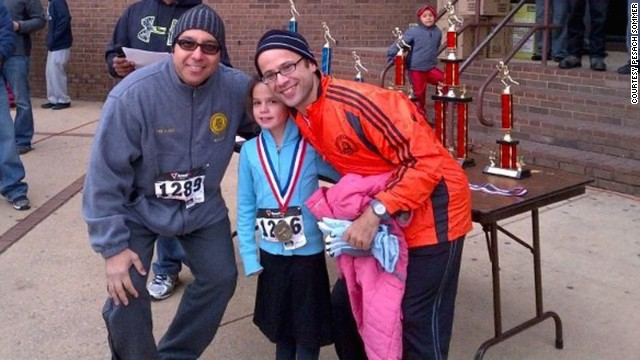 Mayor Alex Blanco, Sommer's daughter Maayan and Sommer pose for a photo after a race in Passaic, New Jersey, in October 2013.