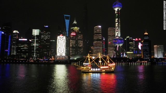 "The vibrant glow of <a href='http://ireport.cnn.com/docs/DOC-1131116'>Pudong</a>, a waterfront area in central Shanghai, reflects against the calm waters of China's Huangpu River. Get to know Shanghai better during the premiere of CNN's <a href='http://cnn.com/video/shows/anthony-bourdain-parts-unknown/'>""Anthony Bourdain: Parts Unknown""</a> on Sunday, September 28, at 9 p.m. ET."