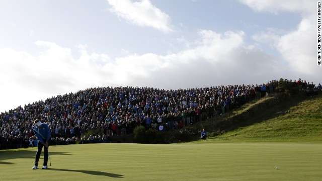 Ian Poulter, one of the stars of Europe's miracle win at Medinah two years ago, putts on the seventh green on Friday morning. Tens of thousands of spectators are attending the three-day event in Perthshire, Scotland.