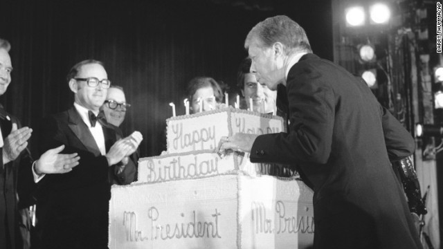 Three days before his birthday in 1978, Carter blows out candles on a birthday cake presented to him at a fundraiser for the Democratic National Committee.