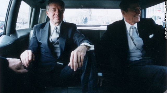 Outgoing President Carter, left, sits with President-elect Ronald Reagan en route to Reagan's inauguration in January 1981.