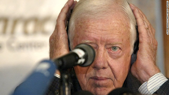 Carter adjusts his headphones at a news conference in Caracas, Venezuela, in January 2003. He proposed a referendum on Venezuelan President Hugo Chavez's presidency and an amendment to the constitution as a way to end the political crisis in the South American nation.
