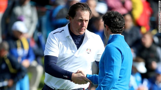 Phil Mickelson shakes Rory McIlroy's hand after claiming a vital point for Team USA in the final fourball match on Friday.