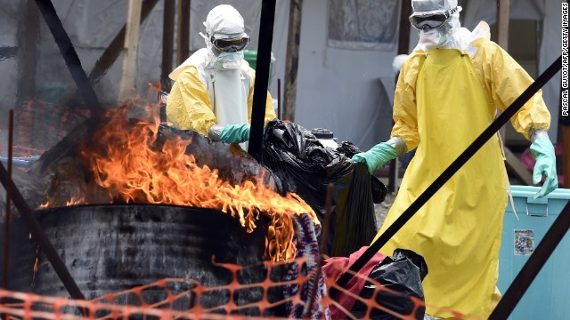 Medical staff members at the Doctors Without Borders facility in Monrovia burn clothes belonging to Ebola patients on Saturday, September 27.