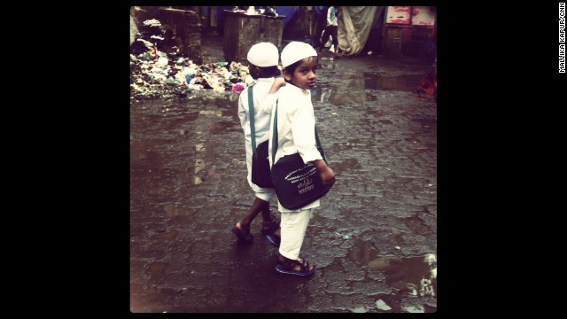 "MUMBAI, INDIA: ""I was out shooting a rather grim story on manual scavenging. While following a scavenger cleaning human excreta from the road, I noticed these two young boys going to or coming from school. Hand in hand, full of smiles, one shot a curious look at our camera when he thought I wasn't looking."" - CNN's Mallika Kapur. Follow Mallika (@mkapur1) and other CNNers along on Instagram at instagram.com/cnn."
