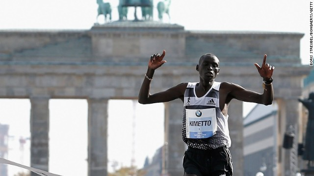 Kenya's Dennis Kimetto breasts the tape in front of the Brandenberg Gate as he sets a new world record in the marathon.
