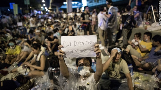 A protester holds a banner during a rally on September 27 outside Hong Kong's waterfront government complex.