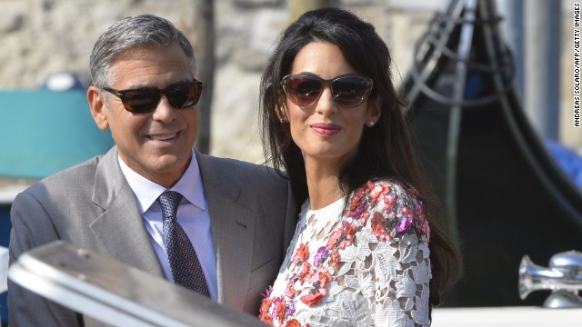Actor George Clooney and his wife, attorney Amal Alamuddin, stand on a taxi boat on the Grand Canal in Venice, Italy, on Sunday, September 28. Clooney and Alamuddin <a href='http://www.cnn.com/2014/09/29/showbiz/italy-george-clooney-wedding/index.html'>married in Venice</a> the previous day at a private ceremony attended by celebrities.