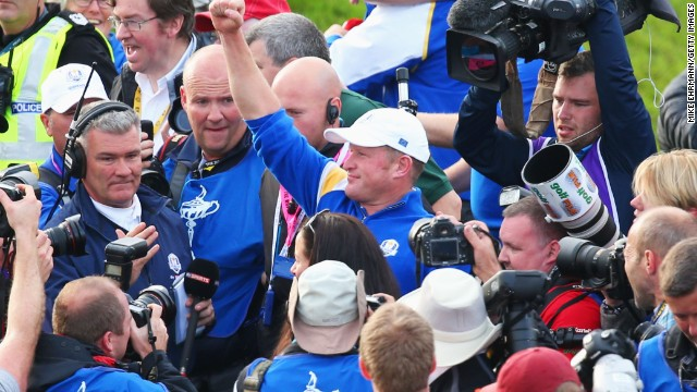 Jamie Donaldson is surrounded by fans and the media after clinching the Ryder Cup for Europe with a win over Keegan Bradley.
