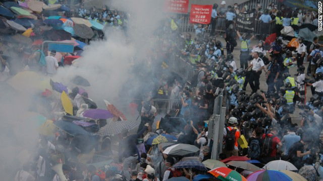 Riot police use tear gas against protesters blocking a main road to Hong Kong's financial central district outside the government headquarters on September 28.