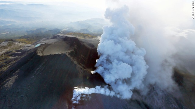 Plumes of smoke and ash billow from Mount Ontake as it continues to erupt on September 28.