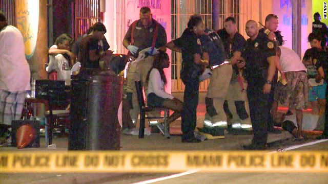 Emergency personnel tend to wounded people outside The Spot, a nightclub in Miami, after a shooting.