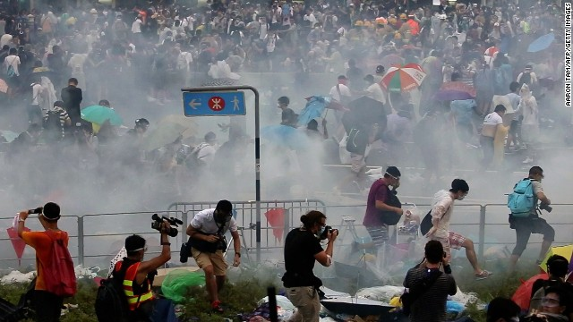 Hong Kong is being gripped by pro-democracy protests as student-led groups take to the streets. The protesters are responding to China's decision to allow only Beijing-vetted candidates to stand in the city's elections for chief executive. Above, tear gas is fired at protesters on Sunday, September 28, 2014. Click through for more scenes from the protests: