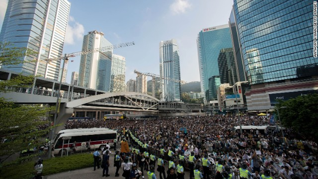 Thousands of people kick off Occupy Central by taking over Connaught Road, one of the major highways in Hong Kong, on September 28.