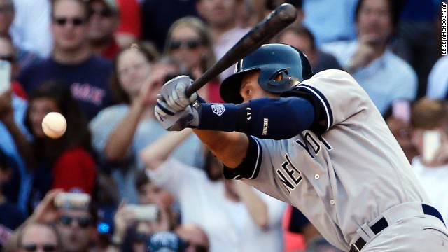 Jeter hits a single against Boston in the final game of his career on Sunday, September 28.