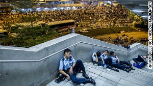 Police and protesters alike grabbed rest as the night wears on.